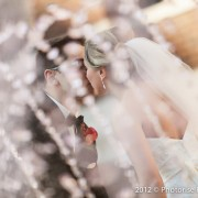Pittsburgh Wedding and Portrait Photography by Photorise - Groom Kissing Bride by Duquesne Chapel Fountain